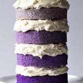 Naked Purple Ombre Layer Cake! Beautiful layers of moist cake made in different hues of purple for a trendy ombre design topped with creamy vanilla buttercream frosting. Easy to decorate and fun to eat! | HomemadeHooplah.com