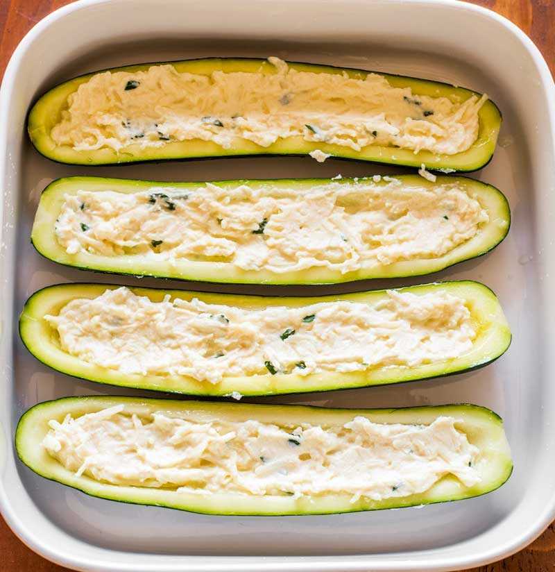 Next, fill each zucchini boat with herb cheese mixture.