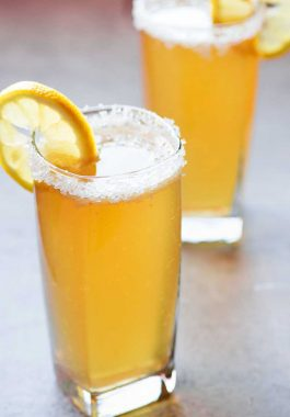 Ginger Beer Shandy! Pair your favorite light beer, ginger ale, and spicy-sweet crystallized ginger for a flavorful beer shandy that'll help you get through those hot summer nights. | HomemadeHooplah.com