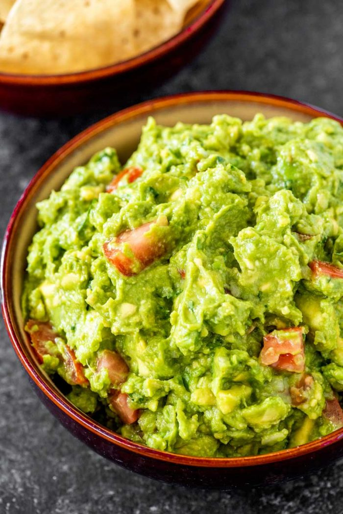 Homeamde Guacamole! Classic guacamole that's ready in 10 minutes and has an extra hint of garlic for a bold flavor. Perfect as a party dip or adding to other southwestern favorites. Plus, make it as mild or as spicy as you like!   HomemadeHooplah.com