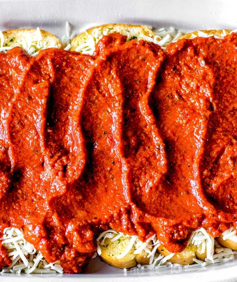 Meatball Sub Casserole! Layers of savory meatballs, creamy mozzarella cheese, and buttery garlic bread make this meatball sub casserole a perfect weeknight dinner. | HomemadeHooplah.com
