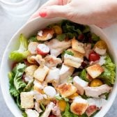 Chicken BLT Salad with Buttermilk Dressing! This BLT without bread has chicken, leafy greens, plump tomatoes, crispy bacon, and homemade buttery croutons covered with a rich buttermilk salad dressing. | HomemadeHooplah.com