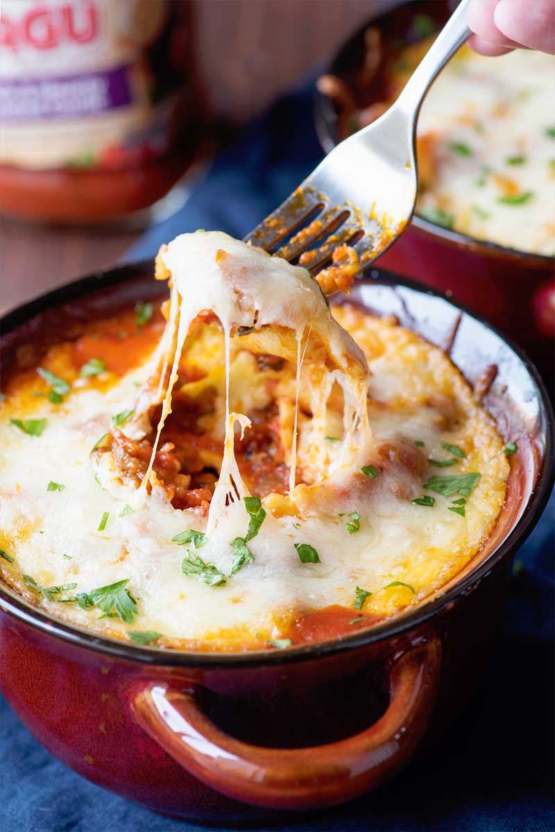 Baked Italian Sausage Ravioli! Cheese ravioli baked in a roasted garlic pasta sauce with Italian sausage, green peppers, and onion, then topped with mozzarella and mascarpone cheese. | HomemadeHooplah.com #ad