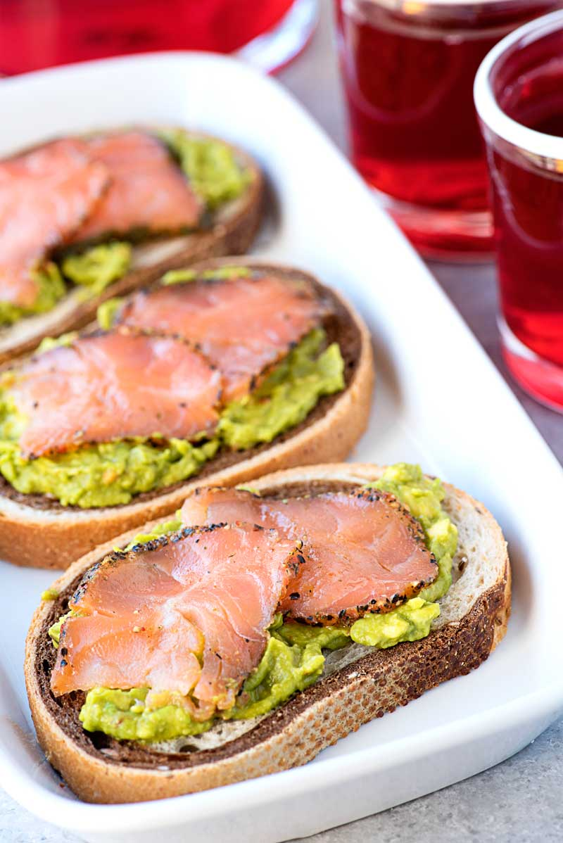 Smoked Salmon on Rye with Passion Tea! A savory smoked salmon appetizer with chili avocado spread on rye bread and served with Tazo® Passion® Tea that you can #SipJoyfully. | Homemadehooplah.com #ad