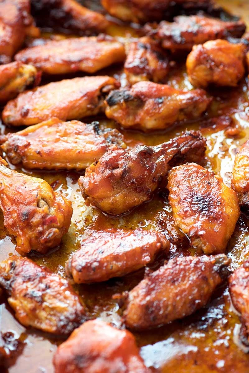 Baked Piri Piri Chicken Wings! Baked in chili-garlic oil and coated in a spicy-sweet sauce, these piri piri chicken wings will be a hit for your next weeknight diner or game day feast! | HomemadeHooplah.com