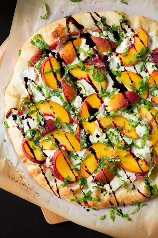 Three Cheese Peach and Prosciutto Pizza with Basil and Honey Balsamic Reduction