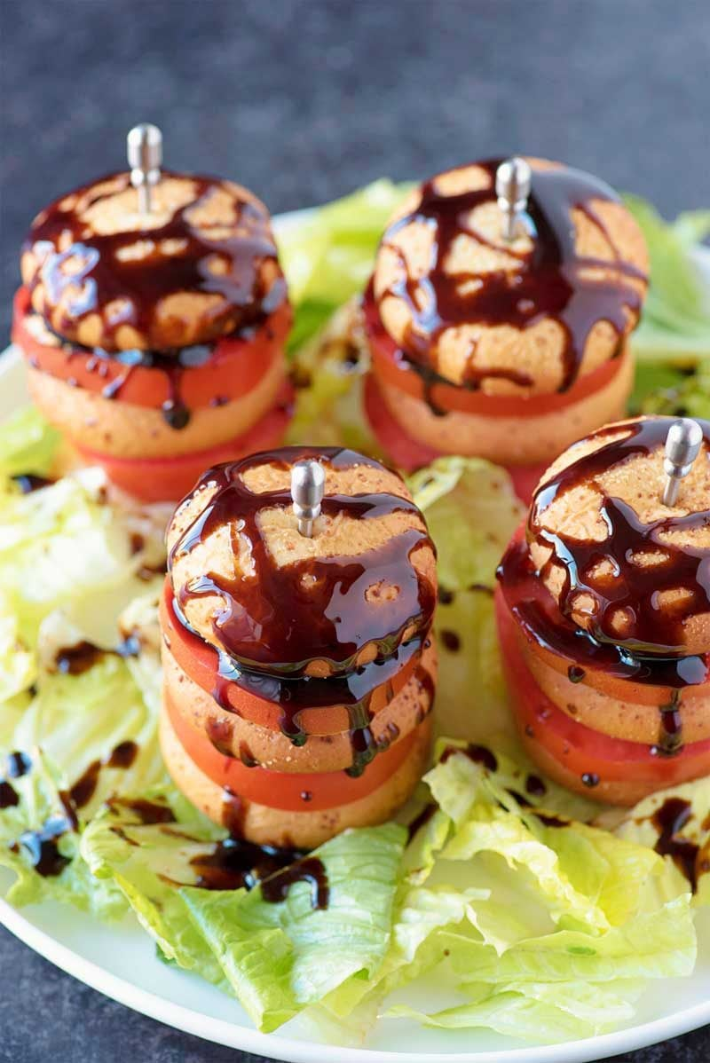 Caprese Mozzarella Bites! Take standard caprese to the next level with Farm Rich's Mozzarella Bites stacked with thick-sliced roma tomatoes and drizzled with balsamic glaze. #ad | HomemadeHooplah.com