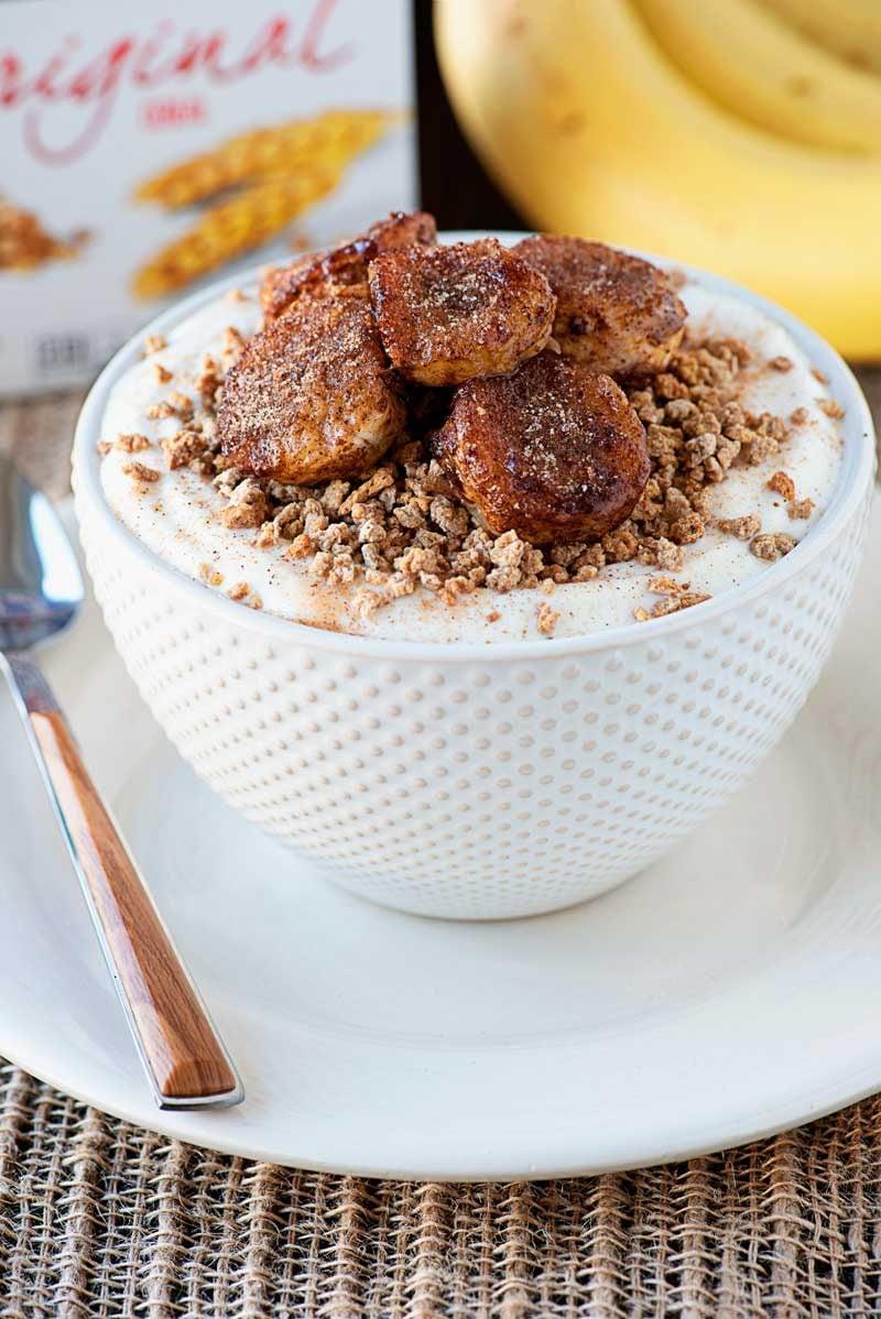 Fried Cinnamon Banana Breakfast Bowls! Creamy greek yogurt topped with Grape-Nuts®cereal and pan fried bananas with a sweet cinnamon coating. An easy and delicious breakfast! #ad #Postfortheholidays #SINGMovieSweeps #PostSave$4 | HomemadeHooplah.com