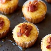 Maple Bacon Cornbread Muffins! Spongy cornbread muffins that are baked & drizzled maple syrup and flavored with rich, crispy bacon. Perfect for a holiday dinner or a unique breakfast! | HomemadeHooplah.com