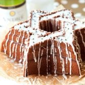 Champagne Bundt Cake! This champagne cake makes the perfect addition to any festive party with its ultra moist pound cake topped with champagne glaze and sprinkles. | HomemadeHooplah.com