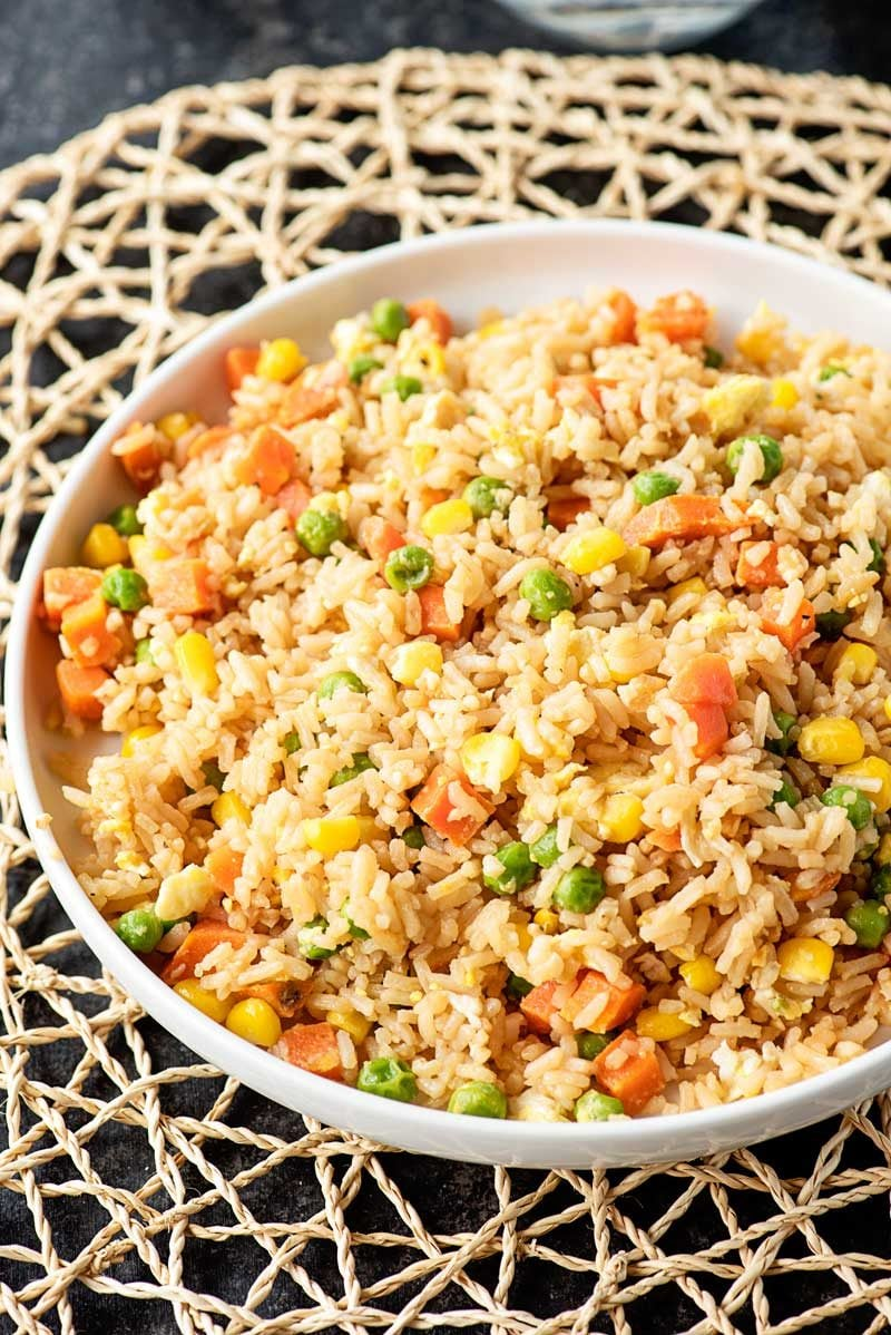 10 Minute Fried Rice! Need a new go-to side dish for busy weeknights? Making fried rice at home is always a great staple, and this easy recipe comes together in just 10 minutes! | HomemadeHooplah.com