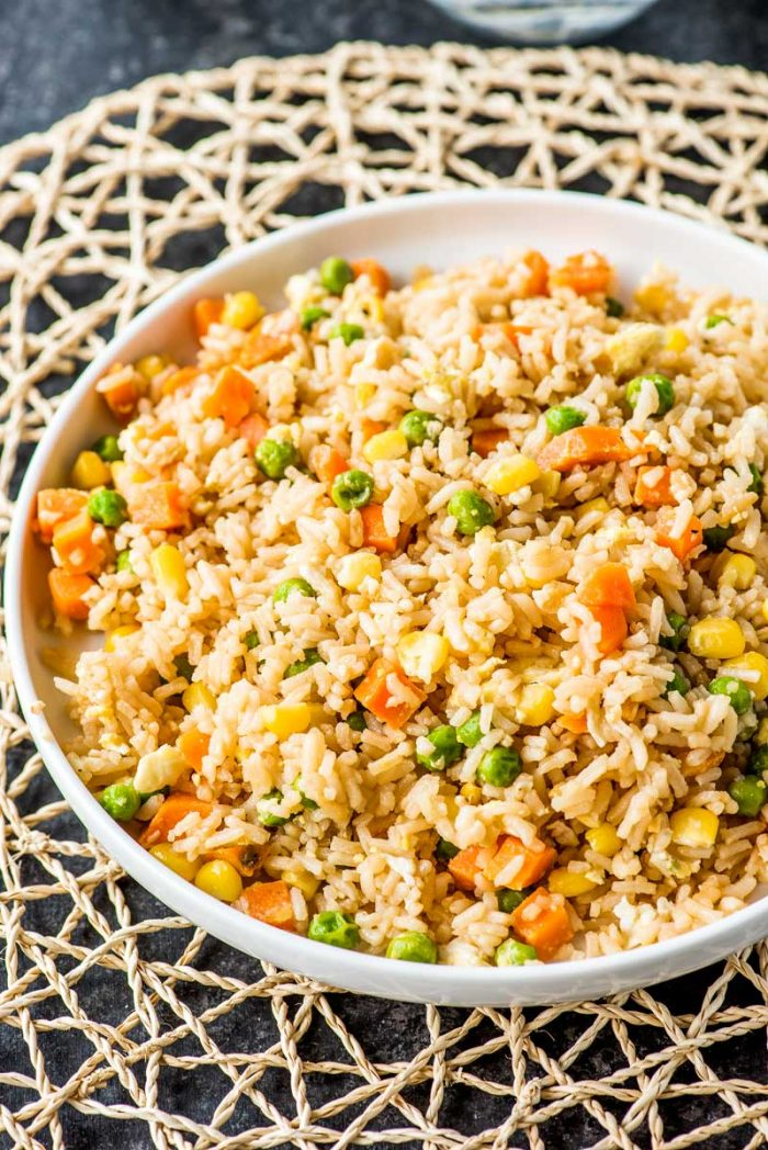 10 Minute Fried Rice! Need a new go-to side dish for busy weeknights? Making fried rice at home is always a great staple, and this easy recipe comes together in just 10 minutes! | familycuisine.net