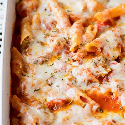 Chicken Penne Casserole! Delicious and tender chicken that's stir fried with bell peppers and onions and then baked in a bed of tomato sauce, penne pasta, and cheese. | HomemadeHooplah.com