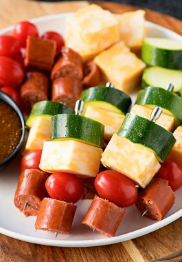 Easy Sausage Skewers! This no-hassle party appetizer is perfect for serving at home or to take on the road! Can be made hot or cold with veggies and dip of your choice! #ad | HomemadeHooplah.com