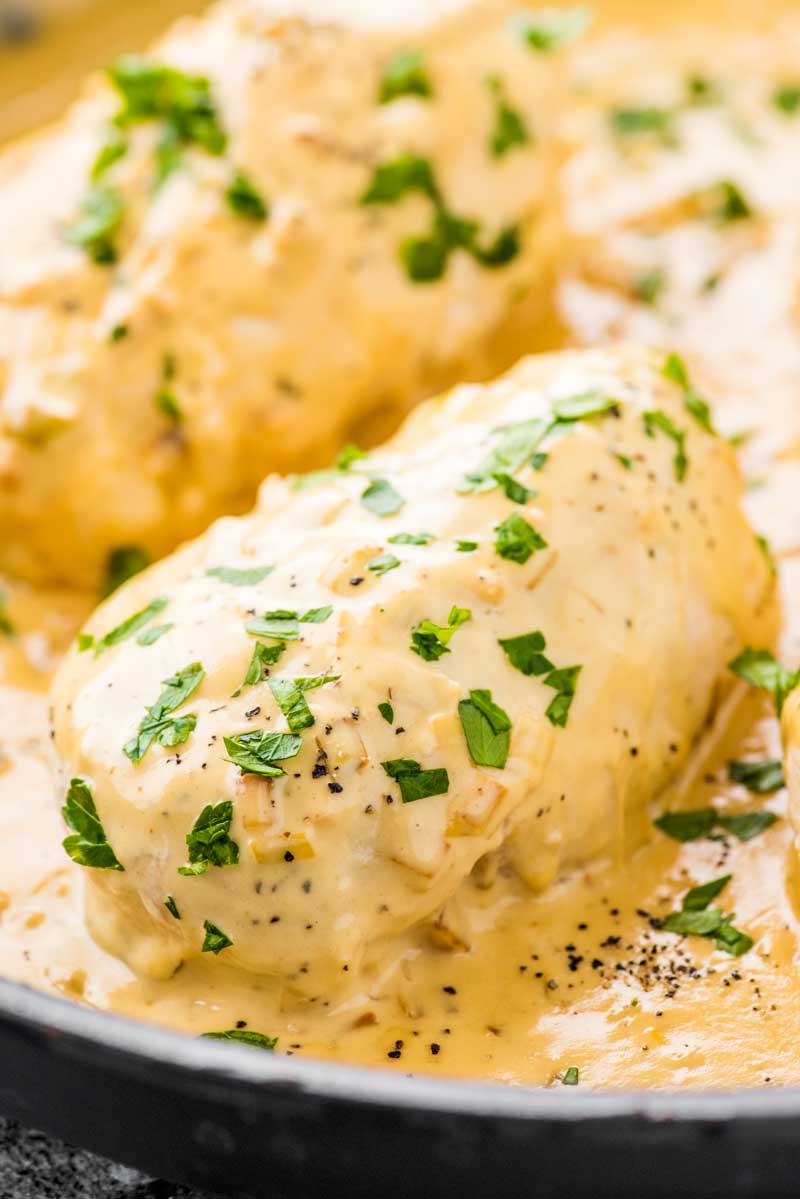 Creamy Dijon Chicken! This one pan dijon chicken is perfect for a busy weeknight and still packs a ton of flavor. Tender chicken breasts are pan-fried and coated in a creamy dijon sauce. Goes great with simple white rice! | HomemadeHooplah.com
