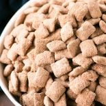 Brownie Puppy Chow! Whether you call them puppy chow or muddy buddies, you're sure to love this bakery makeover of the classic crunchy & sweet snack with rich brownie flavor. | HomemadeHooplah.com