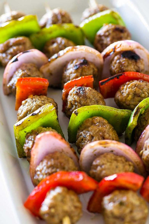 Italian Style Meatball Kabobs! Savory meatballs and classic kabob veggies marinated in an Italian style sauce. These meatball kabobs have twice the flavor for half the effort! | HomemadeHooplah.com #ad #Rosina #WhatsForDinner