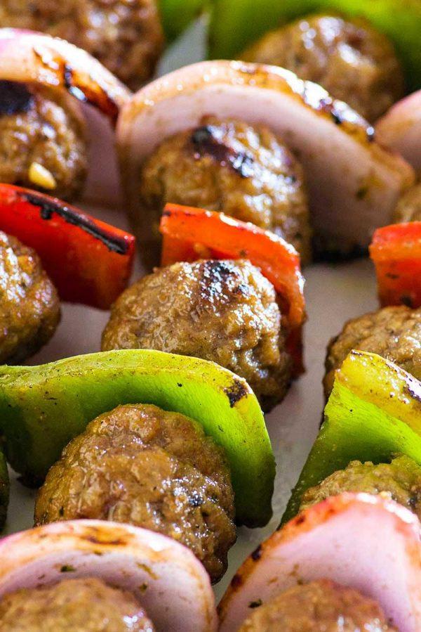 Italian Style Meatball Kabobs! Savory meatballs and classic kabob veggies marinated in an Italian style sauce. These meatball kabobs have twice the flavor for half the effort! | HomemadeHooplah.com #ad #Rosina #WhatsForDinner