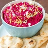 Roasted Beet Hummus! This feta, lemon, and roasted beet hummus is not only tasty (and vibrantly festive!) but it's also a good choice for a healthier lifestyle. Packed with the benefits of chickpeas and beats, this dip is a guilt-free choice for a quick snack or entertaining guests! | HomemadeHooplah.com
