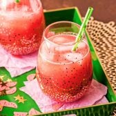 Watermelon Rum Punch! A refreshing watermelon alcoholic punch with hints of citrus and spiked with white rum. It's the perfect watermelon cooler to beat the heat! | HomemadeHooplah.com