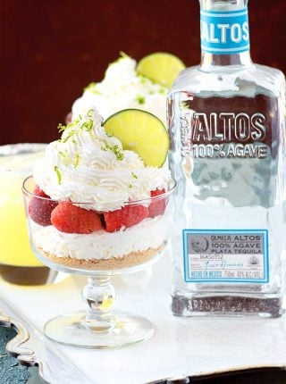 Strawberry Lime Tequila Infused Parfaits! This boozy dessert features strawberries soaked in Altos tequila and lime, then layered with a light and fluffy tequila-lime whipped cream. #ad #AltosTequila #ThisIsOurTequila #FieldNotes @AltosTequila | HomemadeHooplah.com