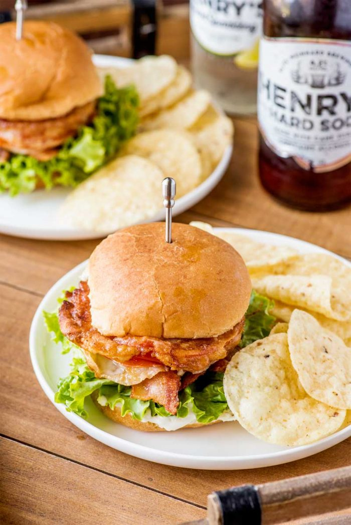 Fried Tomato BLT Sliders! Whether you love fried green tomatoes or just need to use up the red tomatoes from your garden, these BLT sliders are a zesty crowd-pleasing dinner!   HomemadeHooplah.com