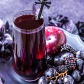 Black Magic Sangria! This black magic drink is a purple punch mixed with blackberries, black grapes, and black plums. Can be made tart (like a witch!) or spellbindingly sweet. | HomemadeHooplah.com