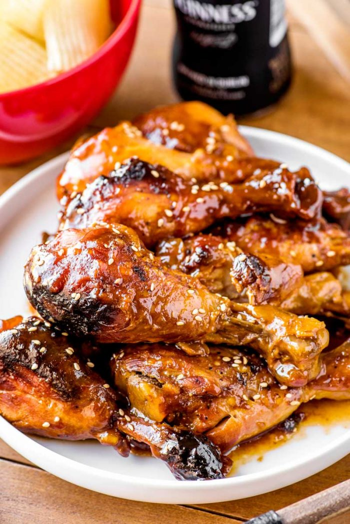 Crock Pot Cranberry BBQ Drumsticks! Chicken drumsticks slow cooked in a cranberry bbq sauce make for an easy weeknight dinner or serving a crowd on game day. It's pure fall comfort food! | HomemadeHooplah.com