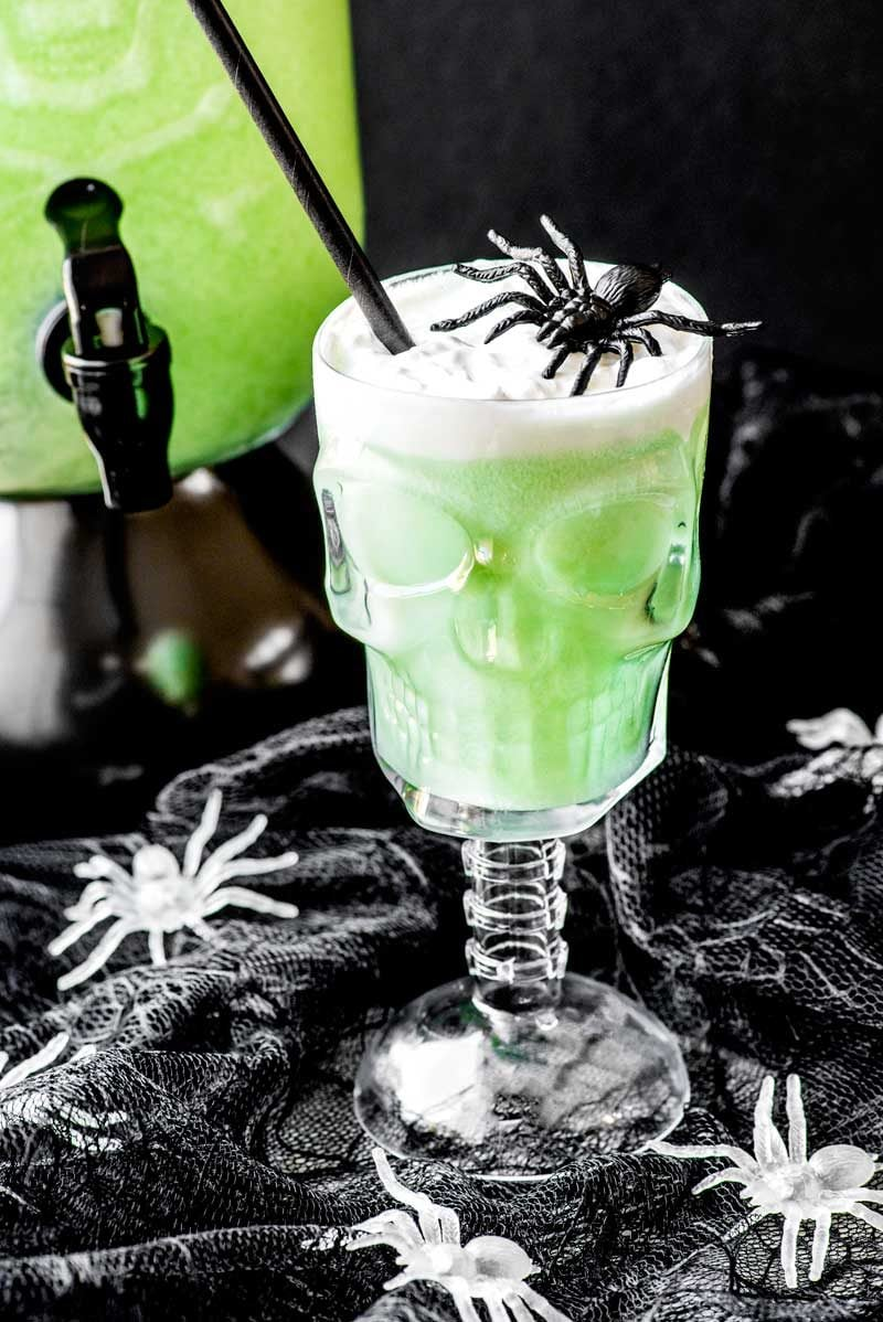 Polyjuice Potion! A family-friendly drink that's perfect for adults and kids, this polyjuice potion only has three ingredients: lime sherbet, lemon-lime soda, and ginger ale! | HomemadeHooplah.com