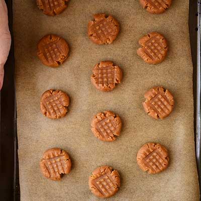 4 Ingredient Peanut Butter Cookies Step 4 - Flatten all cookies.
