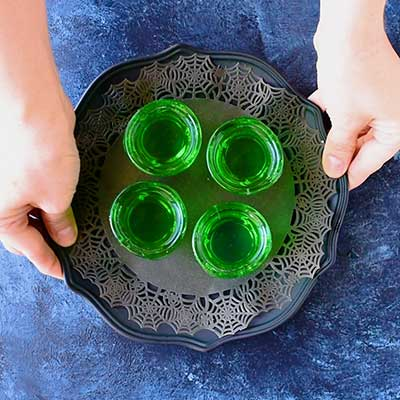 Glow in the Dark Jello Shots Step 4 - Pour jello mix into your chosen cups.
