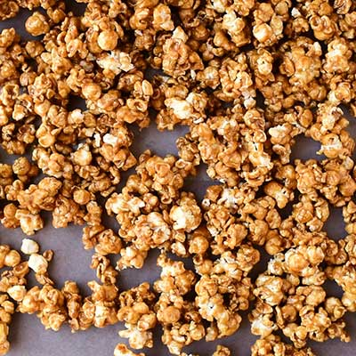Homemade Caramel Popcorn Step 5 - Arrange baked caramel popcorn on a baking sheet.