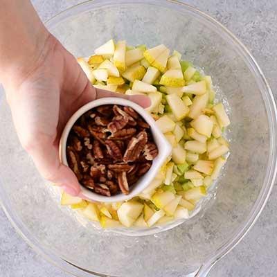 Waldorf Salad Step 2 - Add chopped pecans.