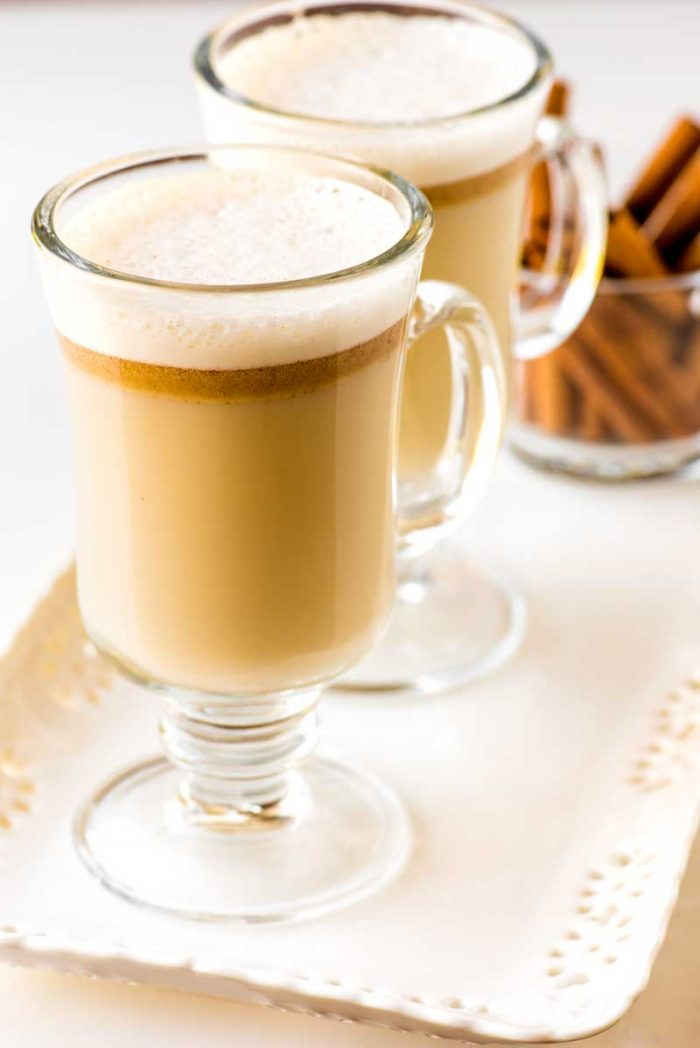 Hot Buttered Rum! A buttery mixture of sugar, ice cream, and spices, this hot buttered rum can be made in advance and served by the glass. Plus it's kid-friendly, too!   HomemadeHooplah..com