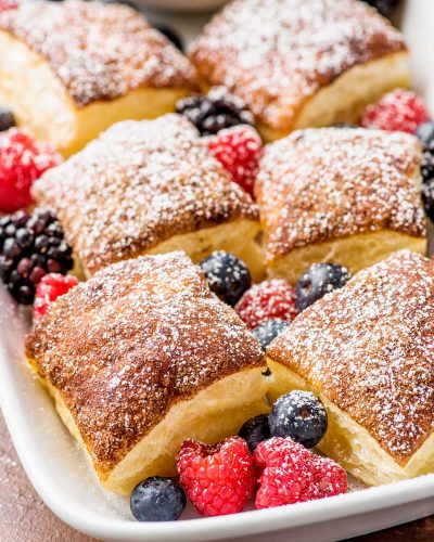Dippable Cinnamon Sugar Puff Pastry Squares! Fluffy Puff Pastry squares topped with a baked layer of cinnamon sugar and served with homemade vanilla whipped cream for dipping. | #ad #InspiredByPuff @PuffPastry HomemadeHooplah.com