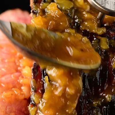 Tangy Pineapple Glazed Ham Step 5 - Spoon glaze onto ham.