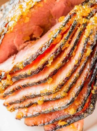 Tangy Pineapple Glazed Ham! Tender Hickory Farms HoneyGold Spiral Sliced Ham baked with a tangy pineapple glazed flavored with Hickory Farms Honey & Pineapple Mustard. | #ad #HickoryFarms #HickoryFarmsHoliday @HickoryFarms HomemadeHooplah.com
