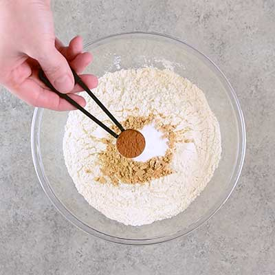 Molasses Crinkle Cookies Step 1 - Add cinnamon.