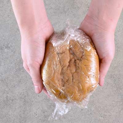 Molasses Crinkle Cookies Step 5 - Wrap dough in plastic wrap.