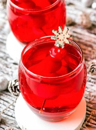 Crock Pot Spiced Cherry Cider! With only three ingredients this cherry cider is easy to make and festively sweet, making it and perfect for any family-friendly party. | HomemadeHooplah.com