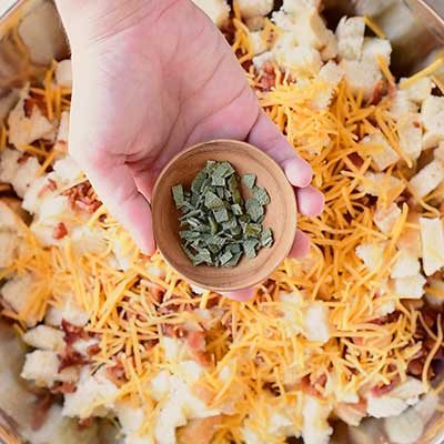 Cheesy Beer Bacon Stuffing Step 5 - Add thyme.