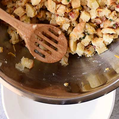Cheesy Beer Bacon Stuffing Step 6 - Add stuffing mixture to baking dish.