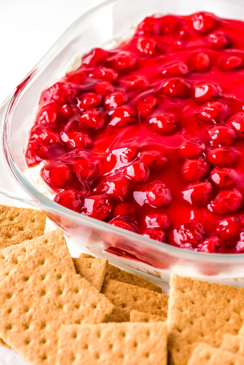 Cherry Cheesecake Dip! Have the taste of classic cherry cheesecake to your party without all the trouble thanks to this easy four-ingredient cherry cheesecake dip. Perfect to make in advance and easy to customize with different cookies or crackers. | HomemadeHooplah.com