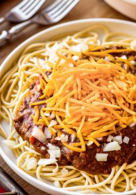 """Crock Pot Cincinnati Chili! An Ohio-favorite dish gets the crock pot treatment with this Skyline Chili copycat recipe. Eat like a Cincinnatian with a chili made with hints of cinnamon and chocolate (that's NOT sweet!) and serve it like the locals do using the authentic """"ways:"""" two-way, three-way, four-way, or five-way. 