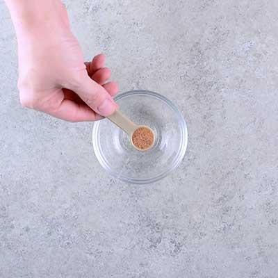 Microwave Peanut Brittle Step 1 - Add nutmeg.