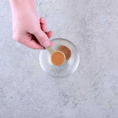 Microwave Peanut Brittle Step 1 - Add cinnamon.