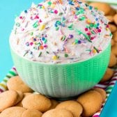 Funfetti Cake Dip! Everything is better with sprinkles, and this funfetti cake batter dip proves it! With only four ingredients and five minutes of your time, you can have a fun party treat that's easy to customize with the perfect sprinkles to fit the occasion. Serve it with cookies or fruit for dipping! | HomemadeHooplah.com