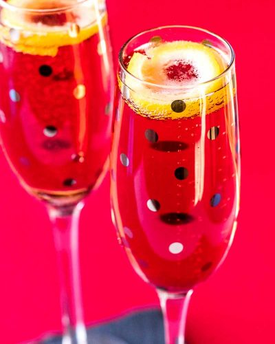 Kir Royale! This festive champagne cocktail combines the bite of dry champagne with the sweet, dark flavor of crème de cassis. A classic kir royal is the perfect dash of flavor and color for any party or celebration!   HomemadeHooplah.com