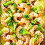 Baked Italian Shrimp! This extremely easy baked Italian shrimp dish is a perfect weeknight dinner for busy seafood lovers. With only four core ingredients, you can have tender shrimp in a buttery Italian sauce in under 20 minutes. Customize it with your favorite vegetables or pasta! | HomemadeHooplah.com