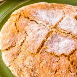 Traditional Soda Bread! An inspiration for countless other recipes, this traditional soda bread only needs four ingredients and comes together quickly (no knead, no rise). And if you'd like to add some extra flavor, it's easy to add other classics like caraway seeds, raisins, or nuts. | HomemadeHooplah.com